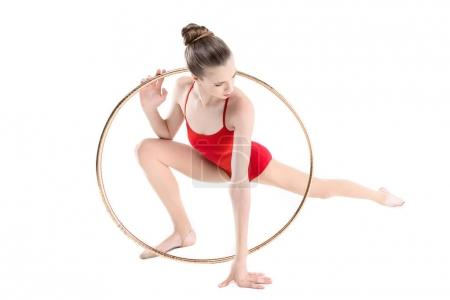 Rhythmic gymnast training with hoop