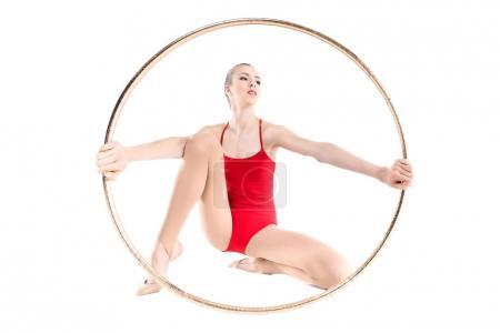 Rhythmic gymnast training with hoop