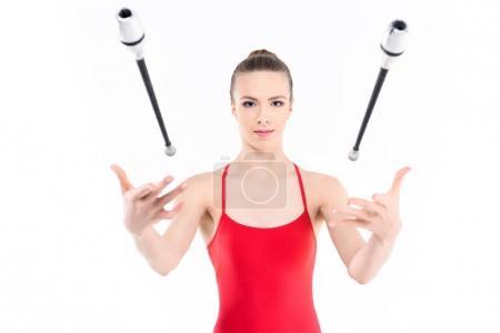 Rhythmic gymnast training with clubs