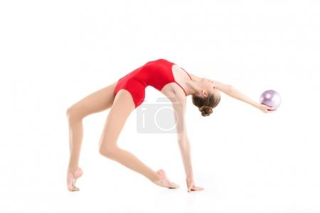 Rhythmic gymnast exercising with ball