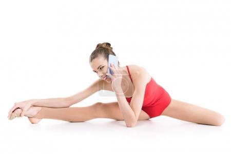 2 rhythmic gymnast talking on smartphone