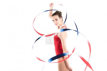 Woman rhythmic gymnast exercising with rope