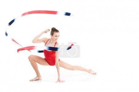 Woman rhythmic gymnast stretching with rope