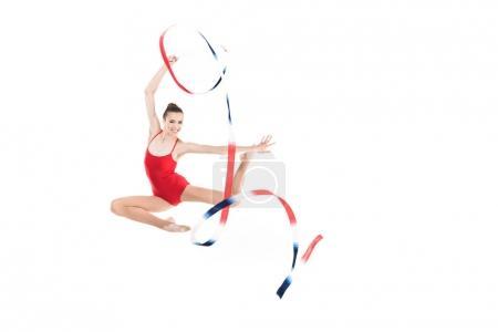 Woman rhythmic gymnast jumping with rope
