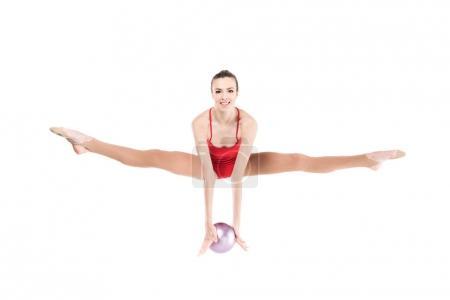 Woman rhythmic gymnast jumping with ball