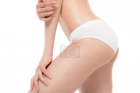 Slim woman in white panties