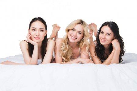 Young beautiful women lying on bed