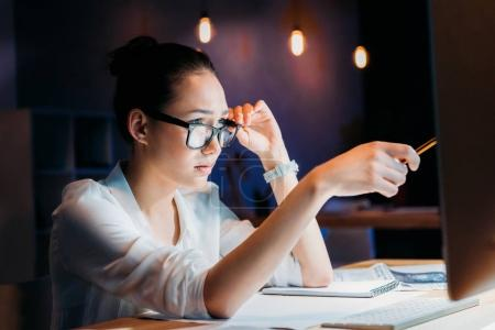 Businesswoman working late in office 4