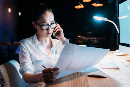 Businesswoman working late in office