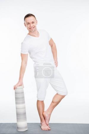 Man holding yoga mat