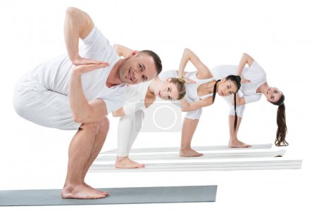 Women practicing yoga with trainer