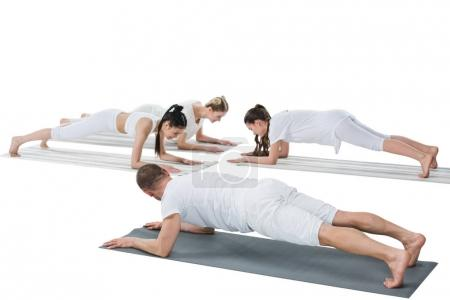 Women doing plank pose with instructor