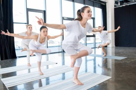 Girls doing yoga Stance with instructor