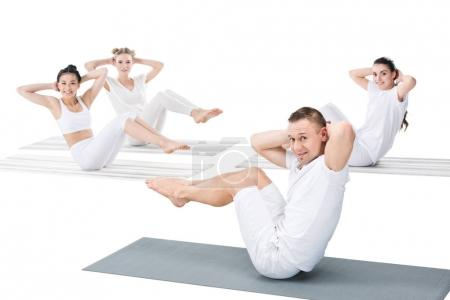 Girls with instructor doing abdominal crunches