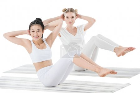 Girls doing side abdominal crunches