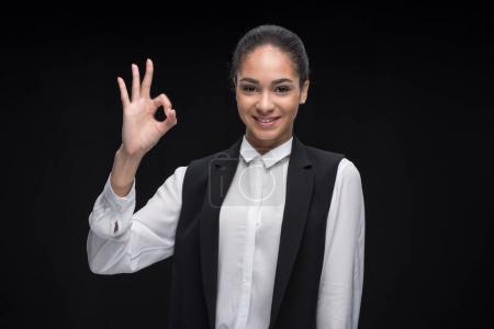 Businesswoman gesturing ok sign