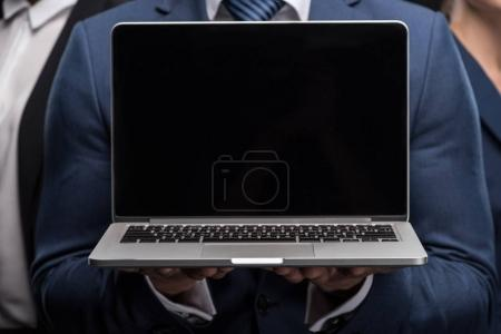 Laptop with black screen in hands