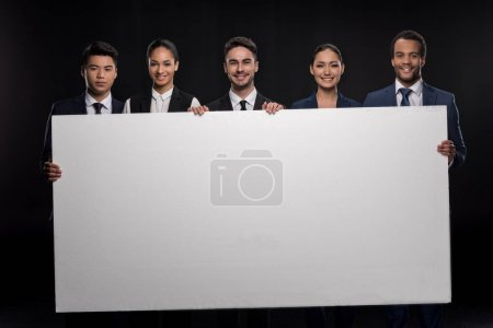 Business people with blank billboard