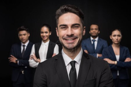 Confident businessman with his colleagues