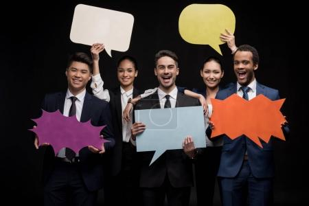 Businesspeople with blank speech bubbles