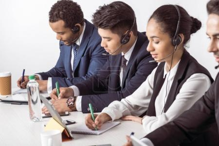 Call center operators in headsets