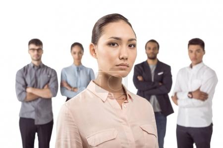 Businesswoman standing in front of colleagues