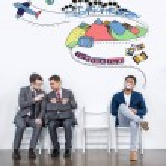 Постер, плакат: Businessmen sitting on chairs