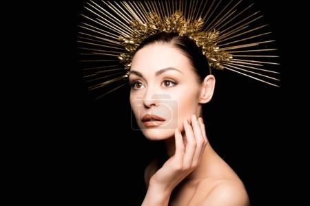 Glamorous woman in golden headpiece