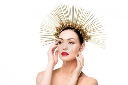 Glamorous woman in golden headpiece