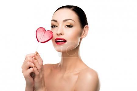 Woman with heart shaped lollipop