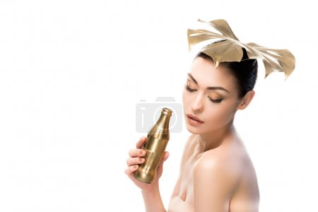 Woman with golden water bottle
