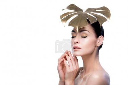 Woman with golden leaf on head