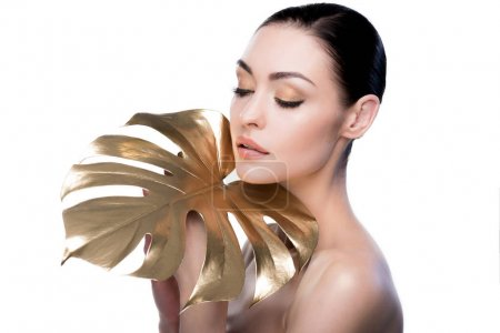 Woman with big golden leaf