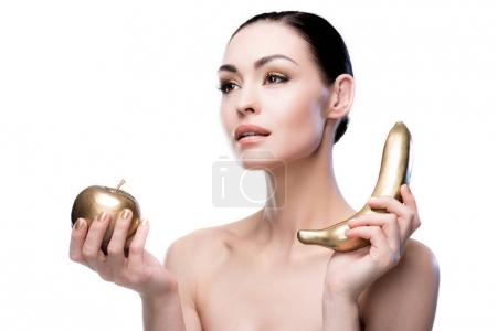 Lady holding golden apple and banana