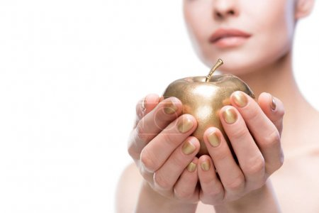 Woman holding golden apple