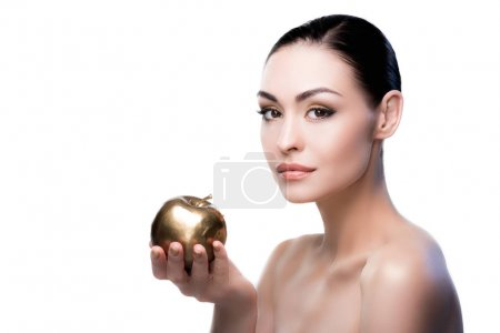 Lady holding golden apple