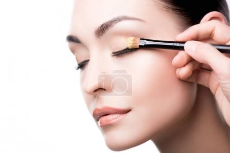 Makeup artist using brush