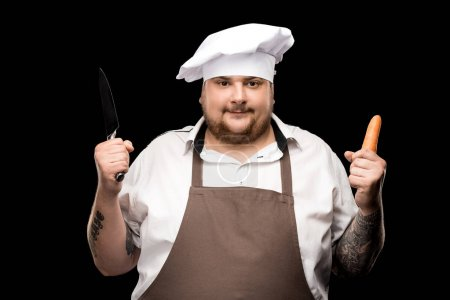 Chef holding carrot