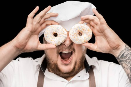 Chef holding doughnuts