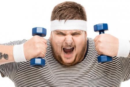 Chubby man yelling while holding dumbbells