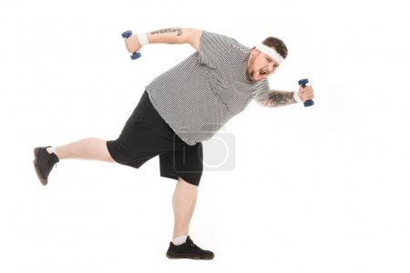 Young obese man running with dumbbells