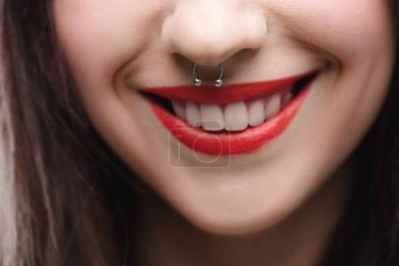 Girl with red lips and piercing in nose
