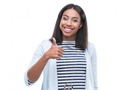 Young woman gesturing thumb up