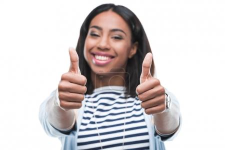 Young woman gesturing thumbs up