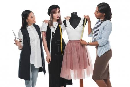 Young fashion designers with dummy