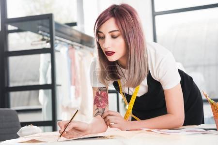 Fashion designer working on sketch