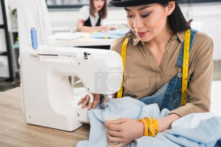 Asian woman working with sewing machine