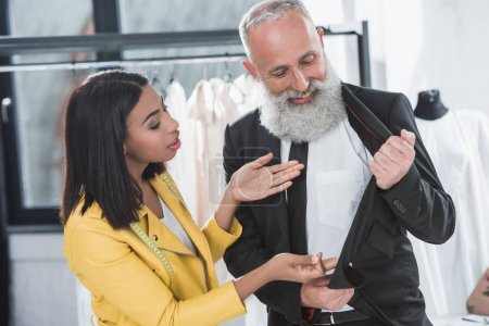 Stylist talking with grey haired client