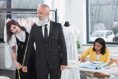 Tailor fitting grey haired man