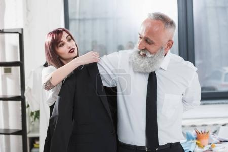 Elderly man with tailor fitting suit